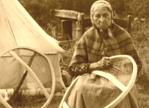Historic  photo of woman making bearpaw snowshoes