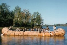 A large Ojibwa freight canoe paddled by  maen from Pikwakanagan Reserve.