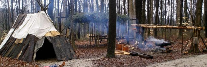 A photograph of a First Nations maple sugar camp.