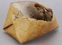 A rustic basket made of birch bark.